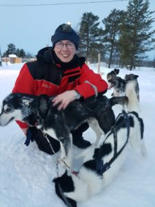 Mike with a husky in Lapland