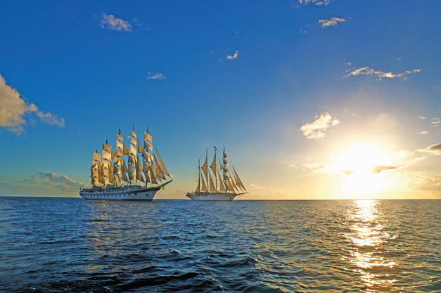 Star Clipper ships on the ocean at sunset